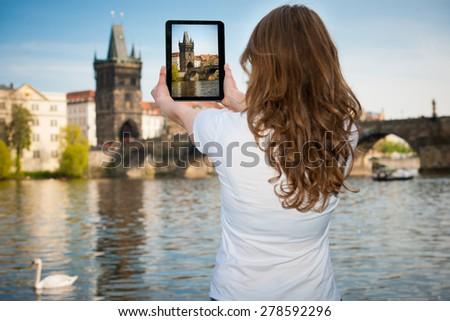 Beautiful young tourist woman photographing sites in Prague Czech republic - stock photo