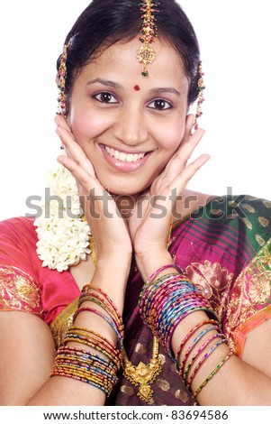 Beautiful young traditional woman against white background