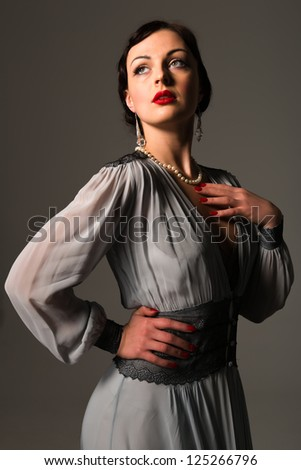 Beautiful young Ukrainian woman vintage gray gown - stock photo