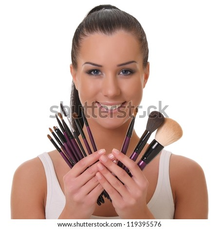beautiful young visagiste. on a white background - stock photo