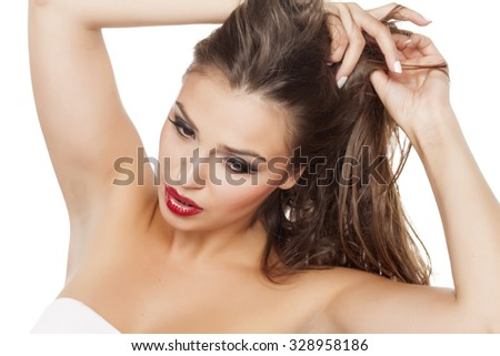 beautiful young woman adjusts her hair