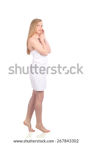Beautiful young woman after bath with towel isolated on white background studio - stock photo