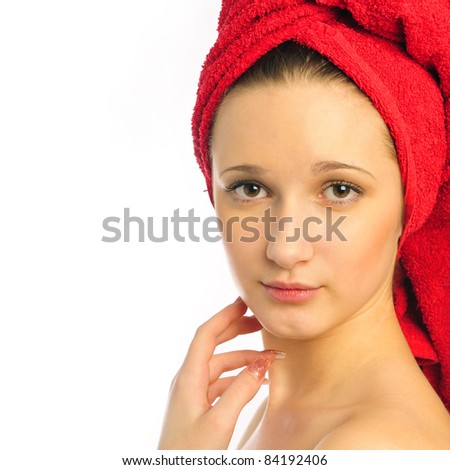 Beautiful young woman after shower with towel on her head - stock photo