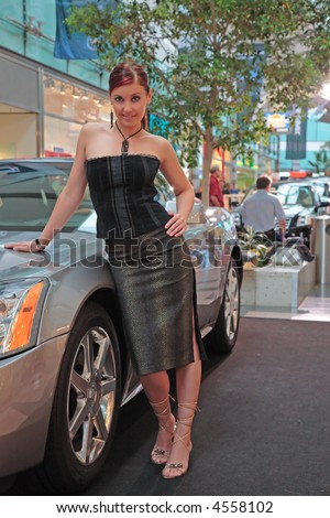 Beautiful young woman and car. - stock photo