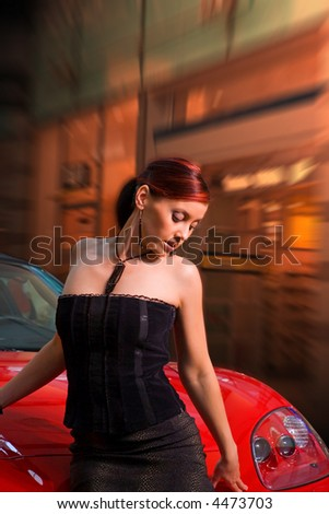 Beautiful young woman and the red sports car. With Clipping Path. - stock photo