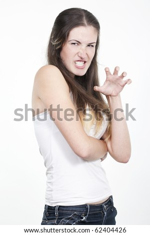 Beautiful young woman angry portrait isolated studio on white background - stock photo