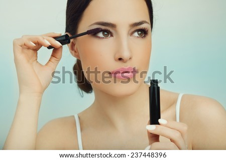 beautiful young woman applied mascara, studio beauty portrait