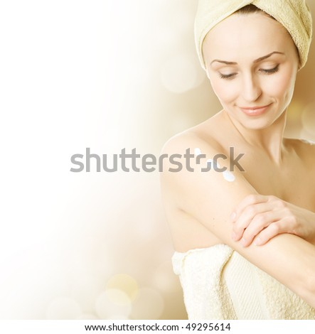 Beautiful Young Woman applying moisturizer.Skincare concept - stock photo