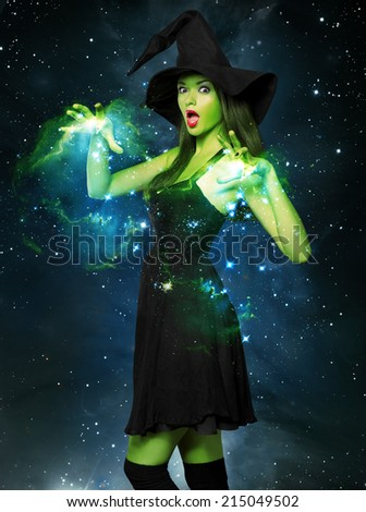 Beautiful young woman as halloween witch-magical portrait - stock photo