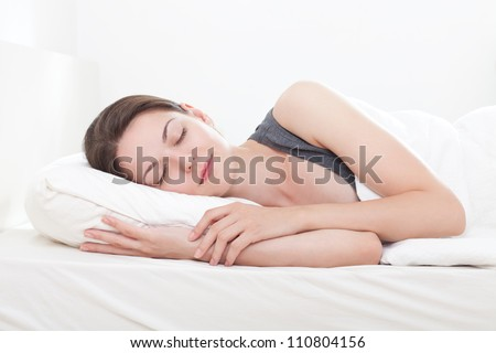 Beautiful young woman asleep, on white background - stock photo