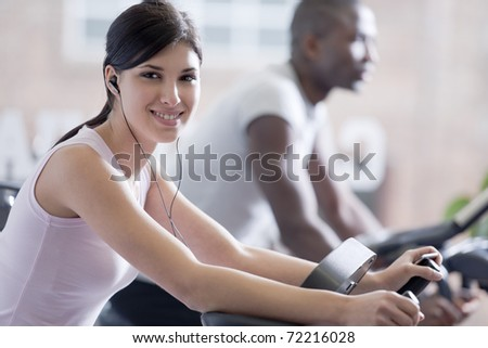 Beautiful young woman at gym - stock photo