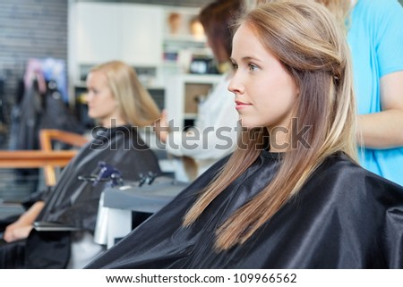 Beautiful young woman at parlor for haircut - stock photo