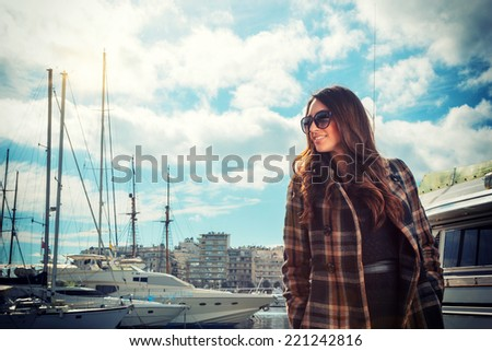 Beautiful young woman at the harbor