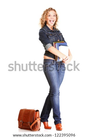 Beautiful young woman blonde 20s standing full body in jeans shoulder bag isolated on white background Caucasian girl