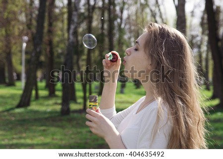 beautiful young woman blowing bubble outdoor happy lifestyle