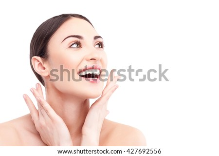Beautiful young woman caring of her body - stock photo