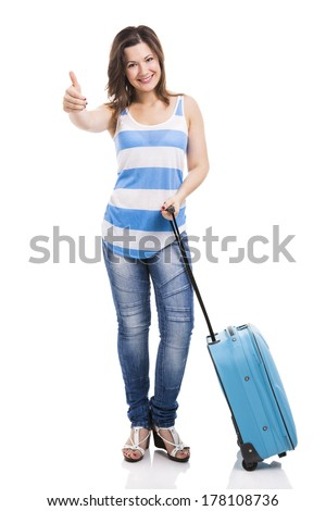 Beautiful young woman carrying her luggage ready for travel, isolated over white background - stock photo