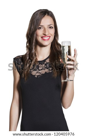 Beautiful young woman celebration christmas and new year with a glass of champagne. - stock photo
