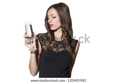 Beautiful young woman celebration christmas and new year with a glass of champagne.