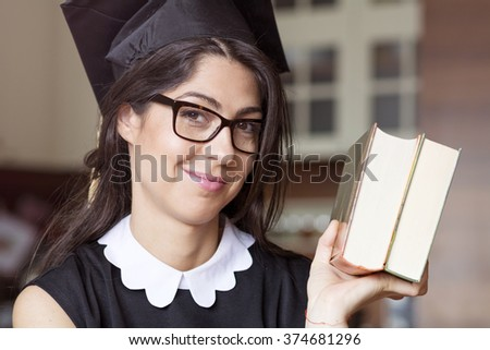 beautiful young woman college graduation with books - stock photo
