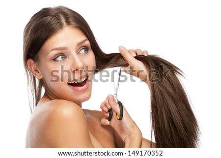 Beautiful young woman cutting her hair, white background