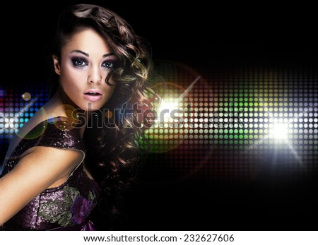 Beautiful young woman dancing - stock photo