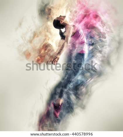 Beautiful young woman dancing and jumping. Modern style dancer posing in studio. - stock photo
