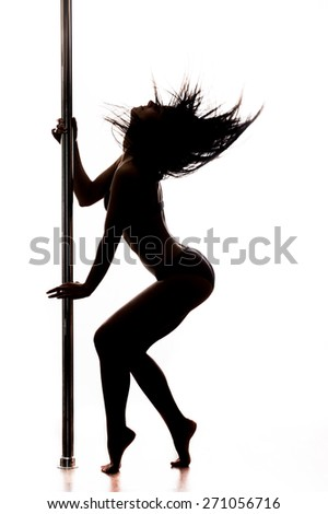 Beautiful young woman dancing at pole
