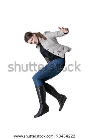 Beautiful young woman dancing the night away - stock photo
