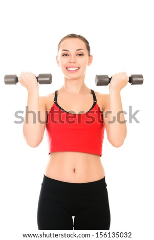 Beautiful young woman doing a fitness workout with weights isolated white background