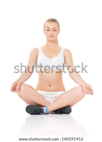 Beautiful young woman doing fitness exercise on the floor, isolated on white background
