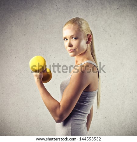 beautiful young woman doing sports - stock photo
