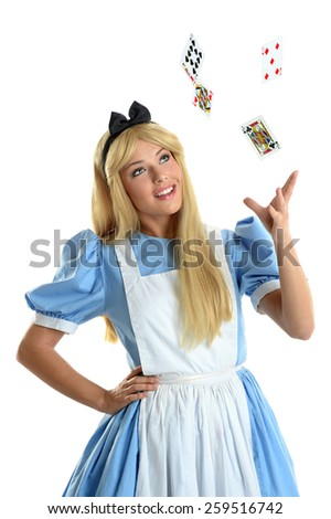 Beautiful young woman dressed in costume throwing playing cards into the air isolated over white background - stock photo
