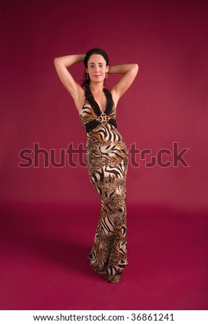 Beautiful young woman dressed in evening dress