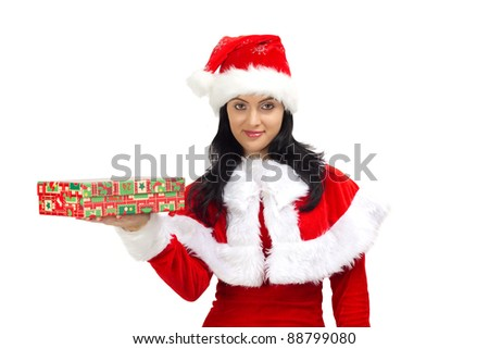 Beautiful young woman dressed in Santa Claus holding a gift - stock photo