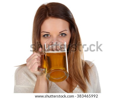 Beautiful young woman drinking beer on white background - stock photo