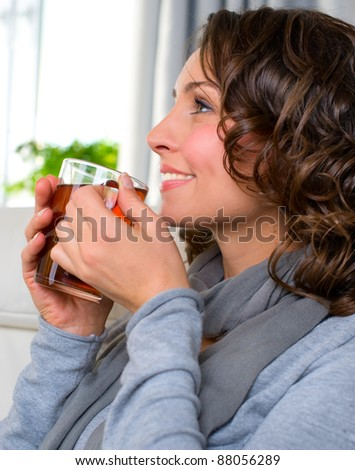 Beautiful Young Woman drinking healthy hot tea