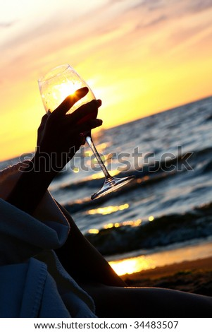 beautiful young woman drinking wine - stock photo