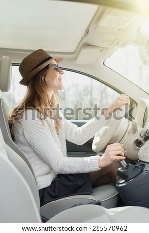 beautiful young woman driving her car - stock photo