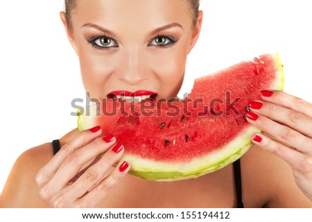 beautiful young woman eat juicy watermelon over white
