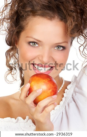 Beautiful young woman eating a red apple.  Close up