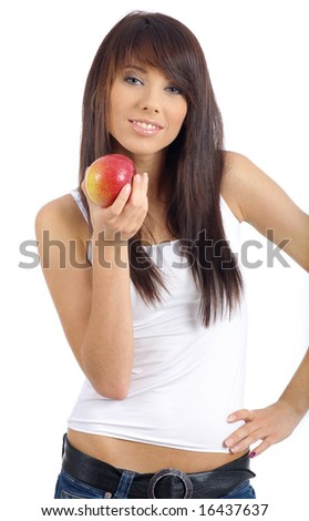 Beautiful young woman eating apple. Isolated over white