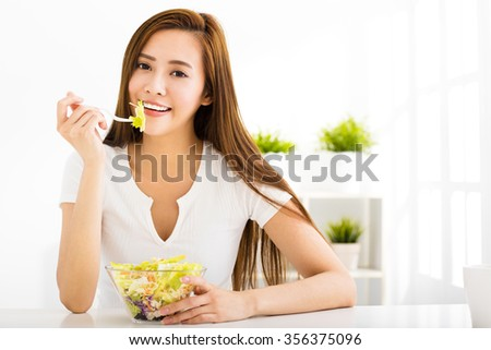 beautiful young woman eating healthy food - stock photo