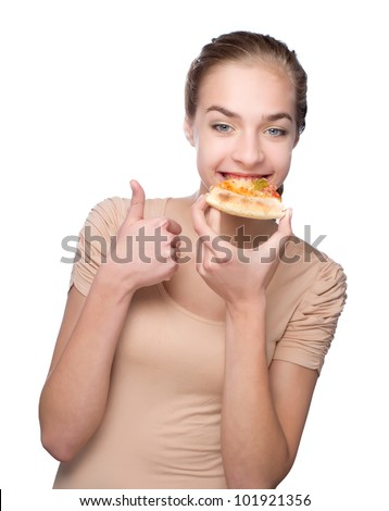 Beautiful young woman eating pizza and showing thumb over white background