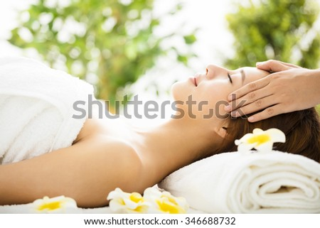 Beautiful young woman enjoy spa salon - stock photo