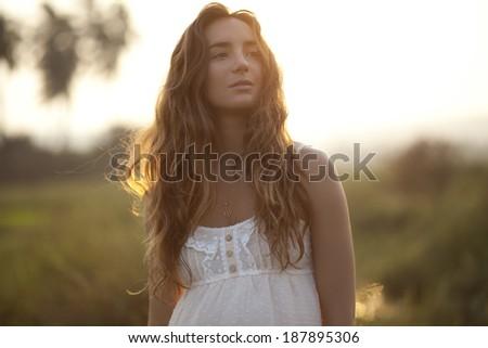 Beautiful Young Woman Enjoying Sunset - stock photo