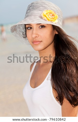 Beautiful young woman enjoying the South Beach shoreline in Miami. - stock photo
