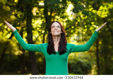 Beautiful young woman enjoys in nature,Peace of mind in nature - stock photo