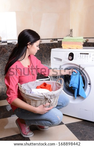 Beautiful young woman erases in house - stock photo