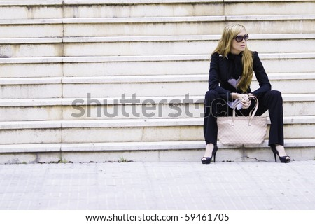 Beautiful young woman executive in the city